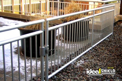 Ideal Shield's Clear Anodized Aluminum Roof Edge Fall Protection Rail with Gate and Buried Base Plates