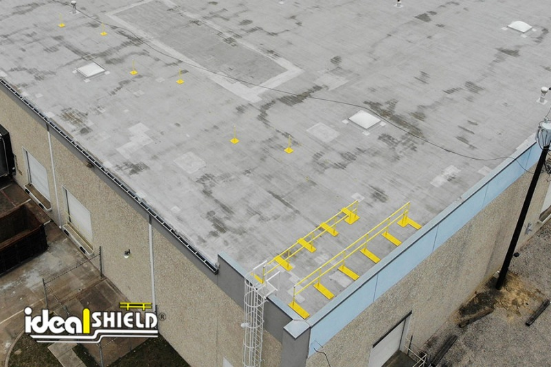 Overhead drone picture of Ideal Shield's Roof Fall Protection Railing and Warning Line System