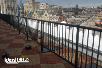 Black Aluminum Rooftop Railing providing fall protection