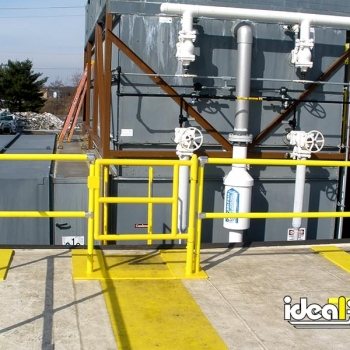 Ideal Shield's Roof Edge Fall Protection Railing with footings and gate entrance