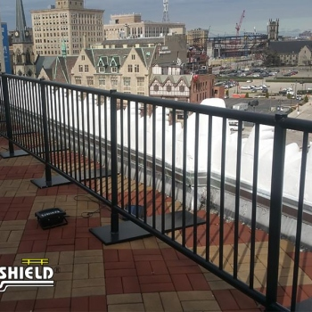Ideal Shield's Black Aluminum Roof Fall Protection Railing with footings at the Detroit Opera House