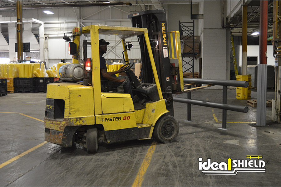 Ideal Shield's Two-Line Standard Guardrail being installed by forklift