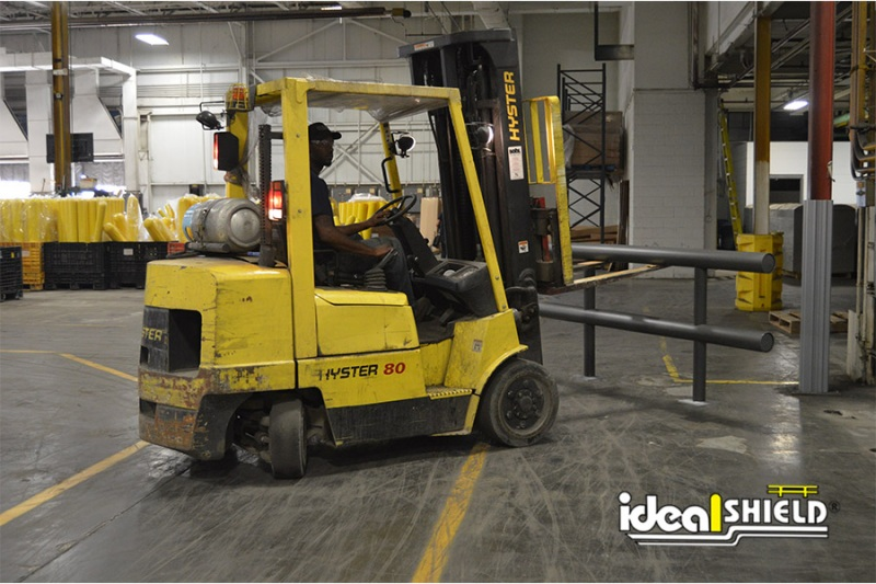 Ideal Shield's Two-Line Standard Warehouse Guardrail being installed by forklift