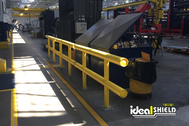 Ideal Shield's Two-Line Standard Guardrail lining a shop walkway