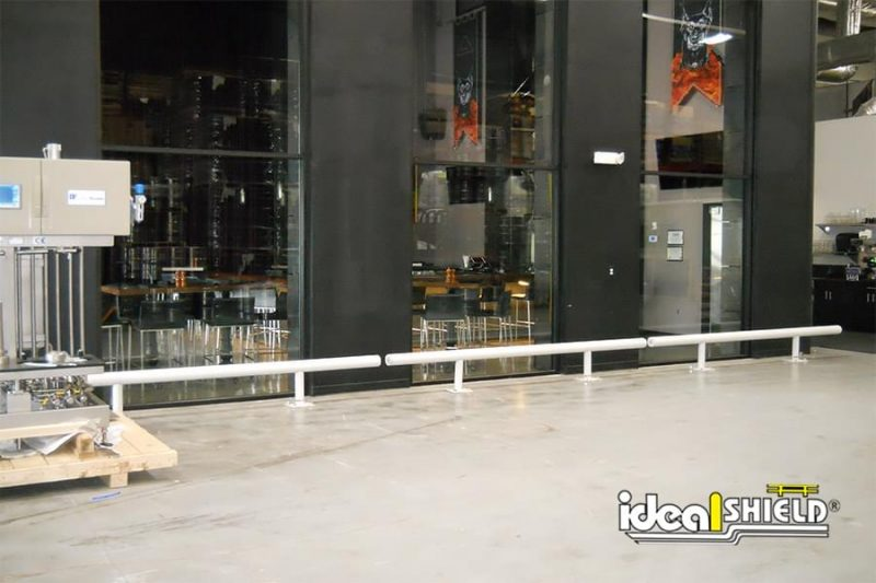 Ideal Shield's One Line Standard White Warehouse Guardrail Creating Barrier along Cafeteria Windows
