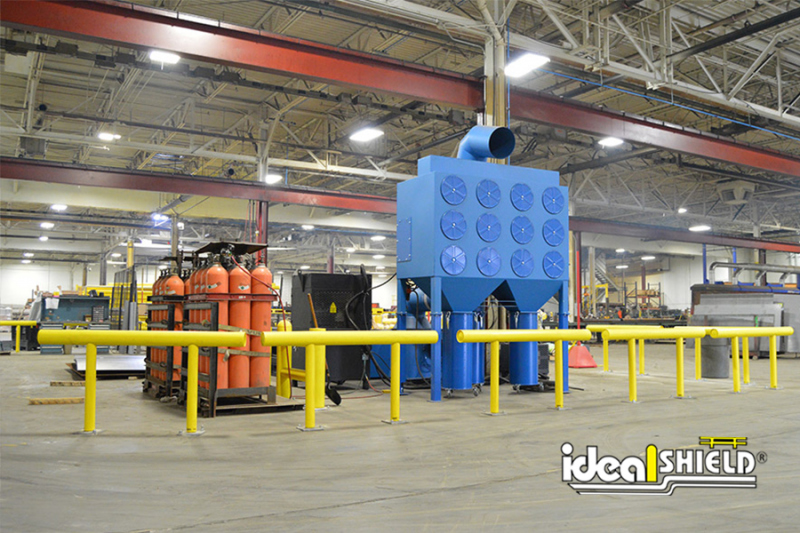 Ideal Shield's One-Line Standard Warehouse Guardrail protecting CNC cutting machine
