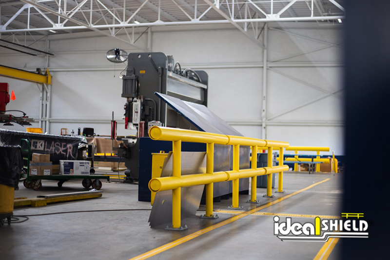 Ideal Shield's Two-Line Standard Guardrail protecting equipment from forklift lane