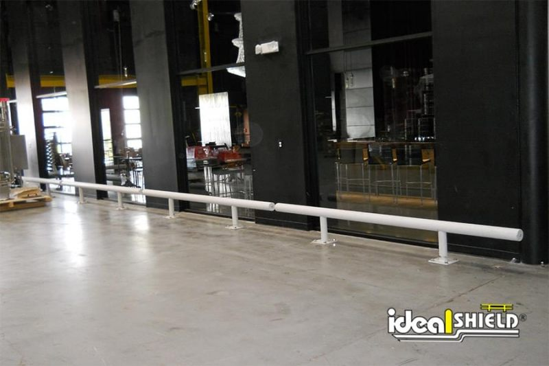 Ideal Shield's One Line White Warehouse Guardrail lining and protecting glass windows