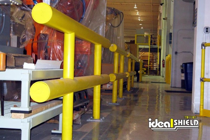 Ideal Shield's Standard Two Line Warehouse Guardrail with Base Plates Protecting Machinery