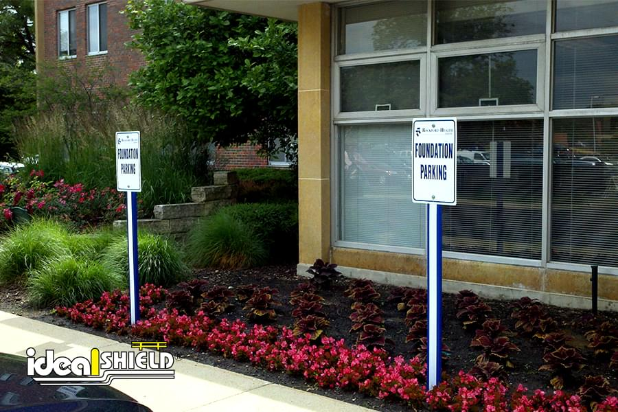 Ideal Shield's Blue U-Channel covers parking lot sign post