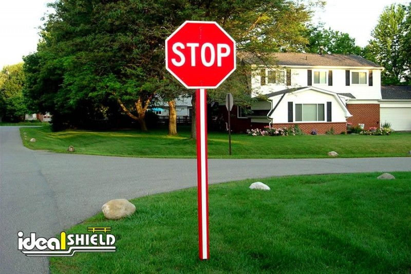 Ideal Shield's Red U-Channel covers Stop Sign post