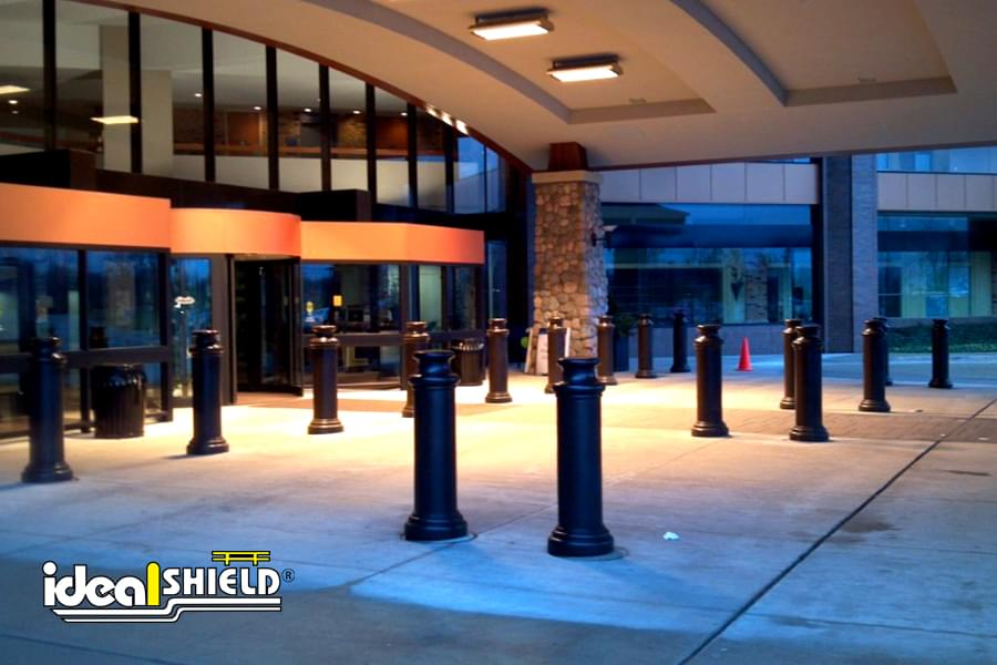 "Ideal Shield's 10"" Pawn Bollard Covers used for protection at a hotel lobby drop off"