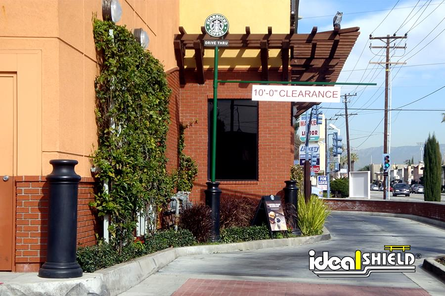 "Ideal Shield's 10"" Pawn Bollard Covers used as drive-thru protection at Starbucks"