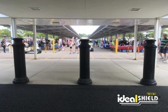 "Ideal Shield's 10"" Pawn Bollard Covers used for crowd control at  Ford"