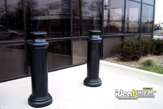 "Ideal Shield's 10"" Pawn Bollard Covers used for building entrance protection"