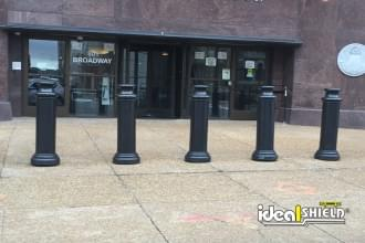 "Ideal Shield's 10"" Pawn Bollard Covers used for protection at an office building entrance"