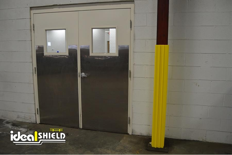 Yellow Square Column Wrap Providing Protection From Swinging Door