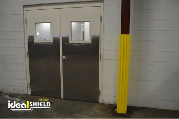 Yellow Column Wrap Providing Protection From Swinging Door