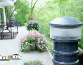 Ideal Shield's Hard Wired Lighted Bollard Cover lighting a garden path