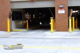Yellow UV Lighted Bollard Cover Parking Garage Entry
