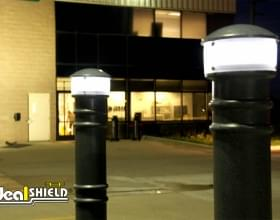 Ideal Shield's Hard Wired Lighted Bollard Covers lighting a parking lot