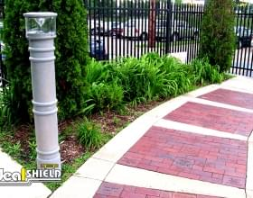 Ideal Shield's UV Lighted Bollard Covers lighting an entrance pathway