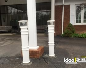 Ideal Shield's white UV Lighted Bollard Covers used for column protection and entrance lighting