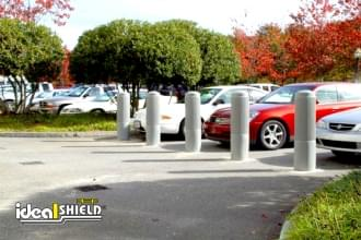 "Ideal Shield's 10"" Ribbed Decorative Bollard Covers used for Parking Lot Separation"