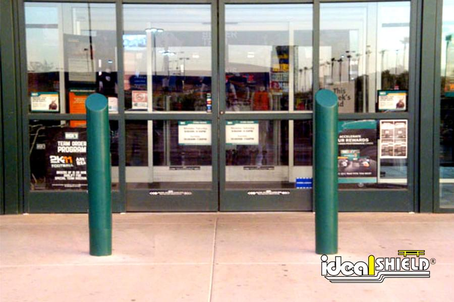 "Ideal Shield's 6"" Skyline Decorative Bollard Cover used for storefront crash protection"