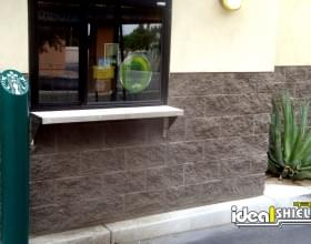 "Ideal Shield's 6"" Skyline Decorative Bollard Covers with custom logo at Starbucks"