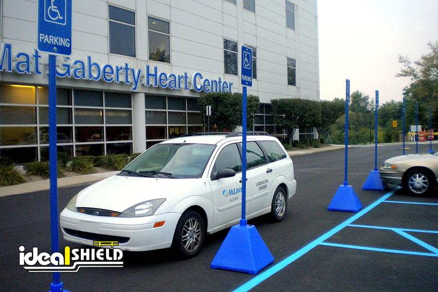 Ideal Shield's portable Pyramid Sign Bases used for handicap accessible parking