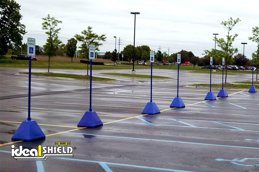Ideal Shield's blue plastic Pyramid Sign Bases used for Handicapped Parking Signs