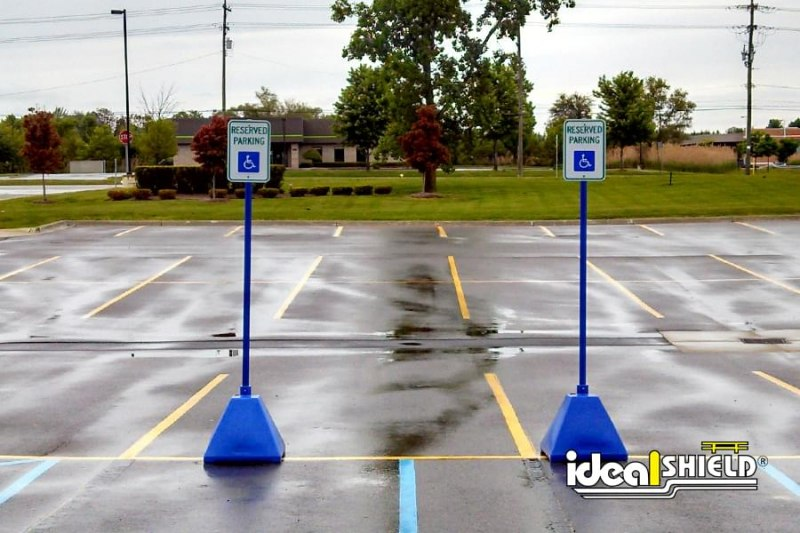 Ideal Shield's portable blue Pyramid Sign Bases for handicap accessible parking