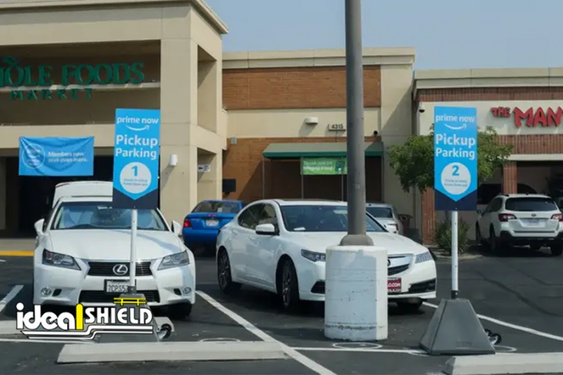 Ideal Shield's Gray Pyramid Sign Bases used for Amazon Prime curbside pickup at Whole Foods