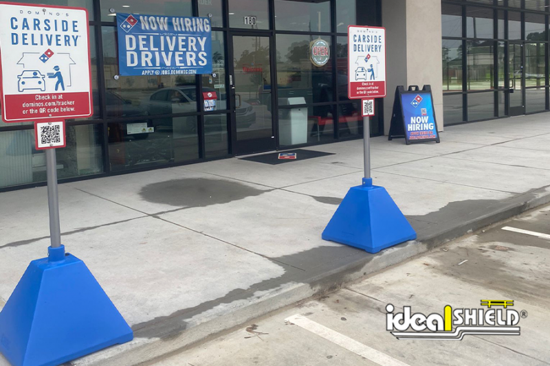 Ideal Shield's Blue Sign Bases used for Dominos Curbside Pickup