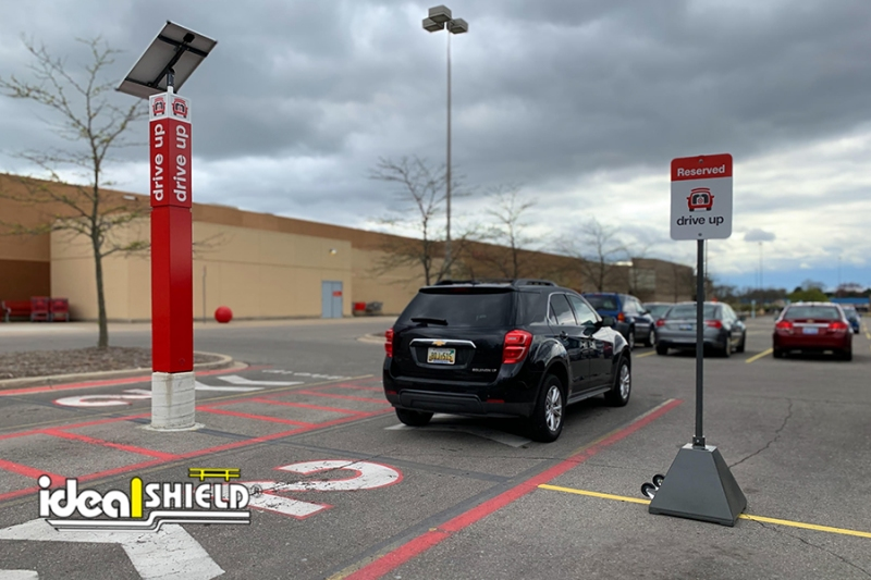 Ideal Shield's Gray Sign Bases used for curbside pickup at Target