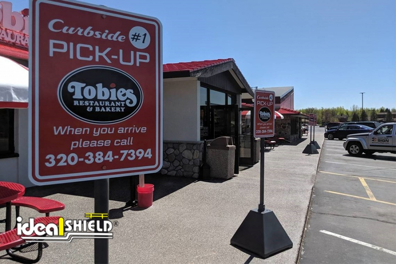 Ideal Shield's Black Pyramid Sign Bases used for curbside pickup