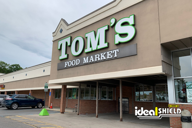 Ideal Shield's Custom Lime Green Sign Bases at Tom's Food Market