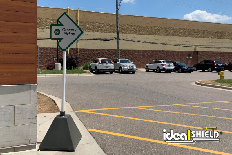 Ideal Shield's Gray Sign Bases used for grocery  pickup at Whole Foods