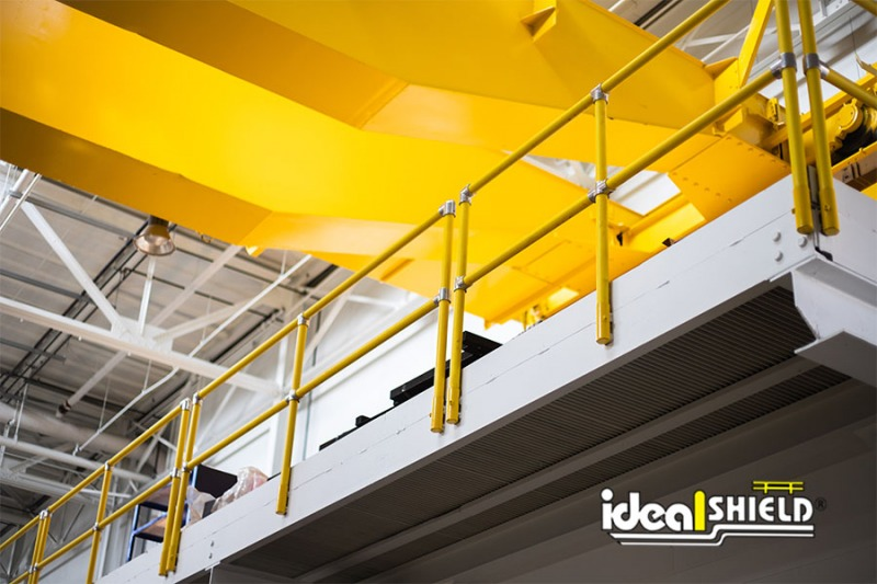 Ideal Shield's Steel Pipe & Plastic Industrial Handrail side mounted to a ledge for fall protection
