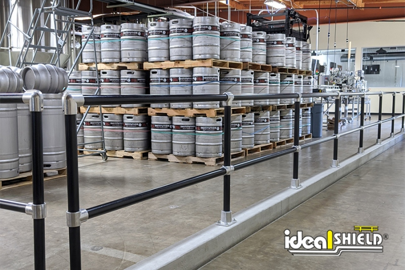 Ideal Shield's Black Steel Pipe & Plastic Handrail at Institutional Ale Co
