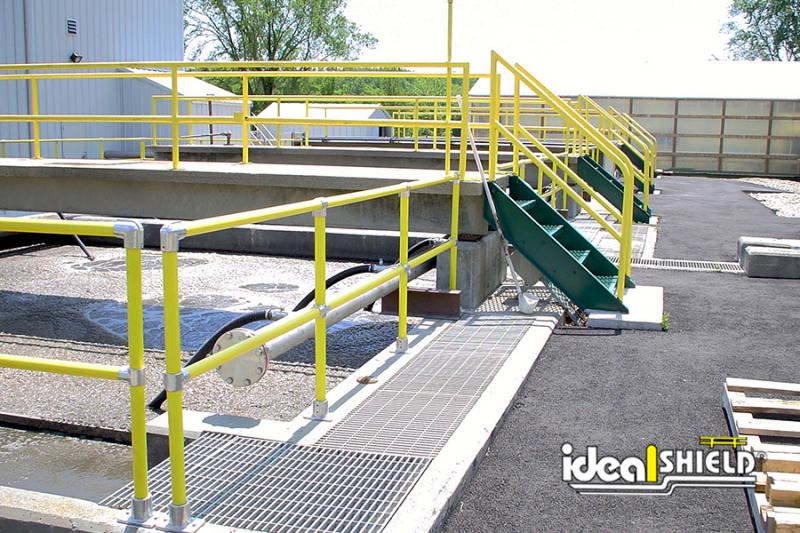 Ideal Shield's Steel Pipe & Plastic Handrail lining a rooftop walkway