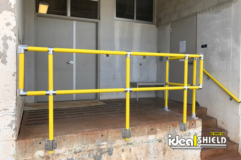 Ideal Shield's Steel Pipe & Plastic Handrail side mounted for exit stairway