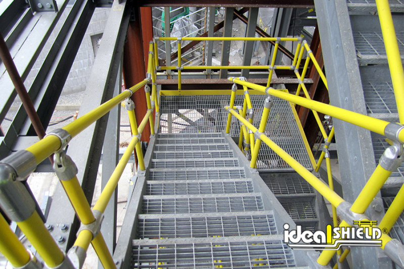 Ideal Shield's Steel Pipe & Plastic Handrail down industrial stairs