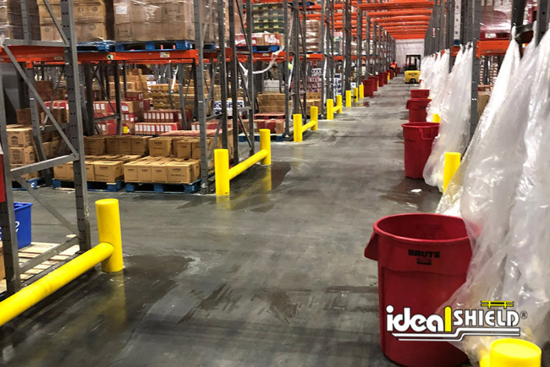 Long line of Ideal Shield's One-Line Cored Rack Guard for end of pallet rack forklift protection