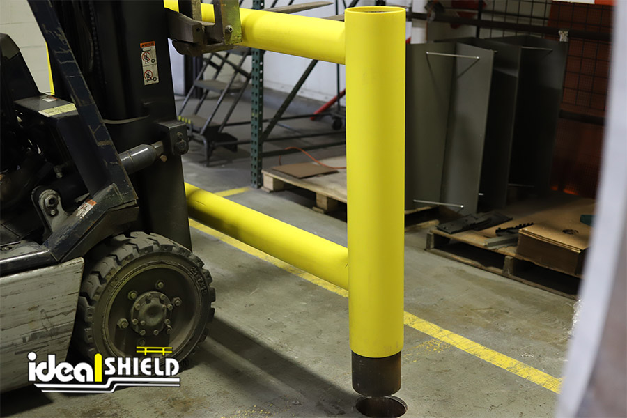 Ideal Shield's Core & Drop Two-Line Rack Guard installed by forklift