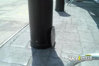 Close up of Ideal Shield's Removable Locking Bollard floor sleeve