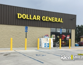 "Ideal Shield's yellow 1/8"" Bollard Covers and Bollard Sign Systems used for storefront protection at Dollar General"