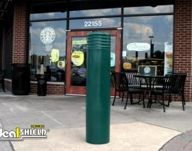 "Ideal Shield's 10"" Green Cinco Bollard Covers in front of Starbucks"