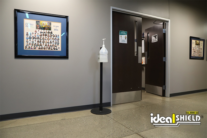 Ideal Shield's Sanitizer Stand in all black with Cup Mount in hallway